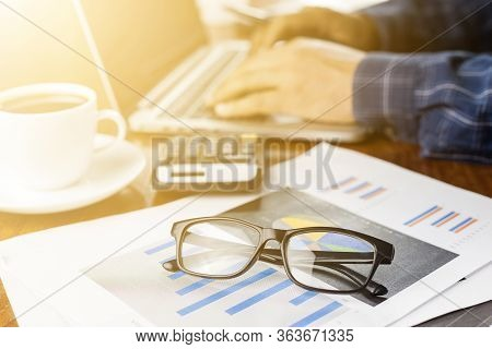 Businessman Working With Modern Workplace With Laptop On Wood Table, Man Hand On Laptop Keyboard For