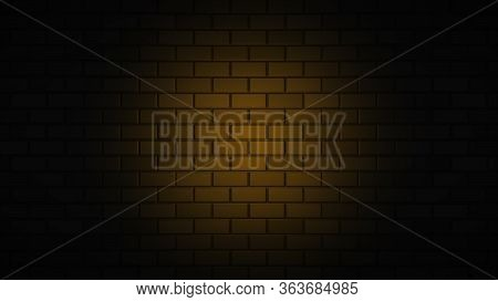 Black Brick Wall With Orange Neon Light With Copy Space. Lighting Effect Orange Color Glow On Brick