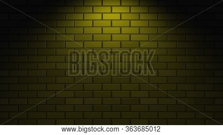Black Brick Wall With Yellow Neon Light With Copy Space. Lighting Effect Yellow Color Glow On Brick