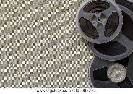 Reels With Magnetic Tape On Beige. Random Bobbins With Audio Recordings. Nostalgia, Pleasant Memorie