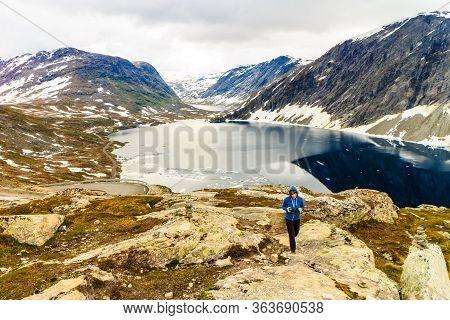 Tourism Holidays And Travel. Woman Tourist Taking Photo With Camera, Enjoying Djupvatnet Lake View I