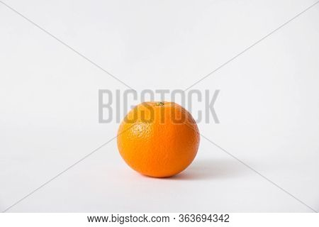 Whole Orange Fruit Isolated On White Background. Single Object, Closeup. Natural Vitamin Or Organic