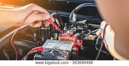 Mechanic Repairman Checking Engine Automotive In Auto Repair Service And Using Digital Multimeter Te