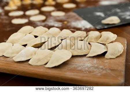 National Dish,raw Dumplings Lie On A Wooden Board,homemade Cooking Dumplings With Meat,beautifully A