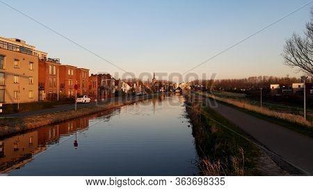 Wooden Drawbridge Called Witte Brug During Sunrise In The Town Of Nieuwerkerk Aan Den Ijssel Over Th