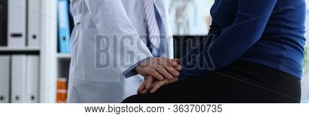 Portrait Of Aged Woman At Examination In Modern Hospital Office. Practitioner In White Uniform Diagn