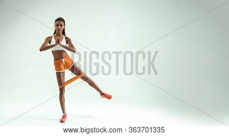 Exercises For Perfect Legs. Full Length Of Young And Slim African Woman In Sports Clothing Exercisin