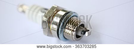 Close-up Of Metal Car Spark Plug Using For Ignition. Device Made From Steel Ceramic And Aluminum. Se