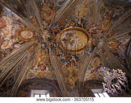 Urbino,  Italy - January 3, 2019: Crystal Chandelier At The Oratorio Di Santo Giuseppe Or Oratory Of