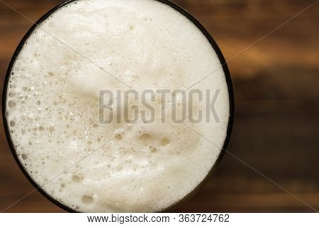 Directly Above Foam Beer In Glass. Close-up Fresh Froth Ale