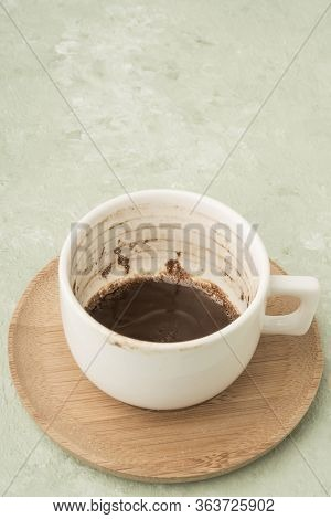 A Cup Of Coffee With Grounds In