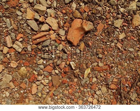 Red And White Granite Fine Gravel. Simple Stone Background With Red Pebbles. Stone Texture. Top View