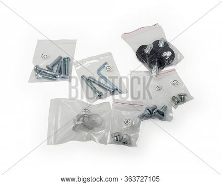 Bolts, Nuts, Fastners, Screws on white with Clipping Path seperated in plastic bags numbered.