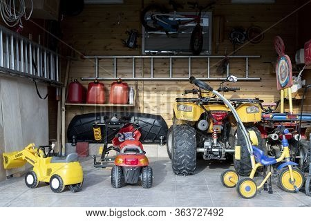 Inside View Open Door Atv Quad Bike Motorcycle Parking Messy Garage, Clutter Stuff, Children Toys An
