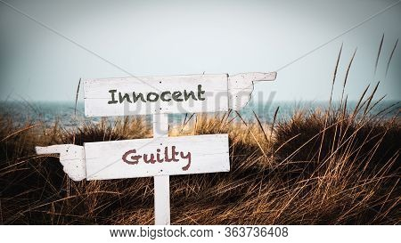 Street Sign The Direction Way To Innocent Versus Guilty