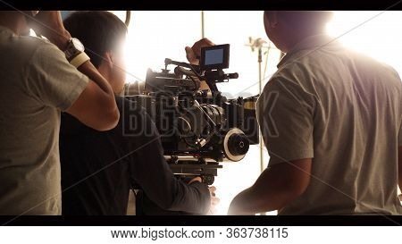 Behind The Shooting Production Crew Team And Hd Video Camera.
