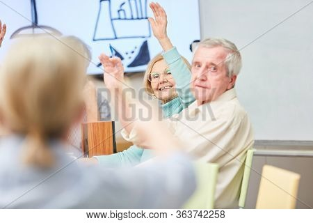 Senior in an adult education course at the adult education center or retirement home
