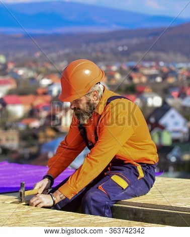 Flat Roof Installation. Roofer Constructing New Roof. Construction Building. Waterproof Sheet Materi