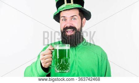 Celebrating Saint Patricks Day In Bar. Bearded Man Toasting To Saint Patricks Day. Irish Man With Be