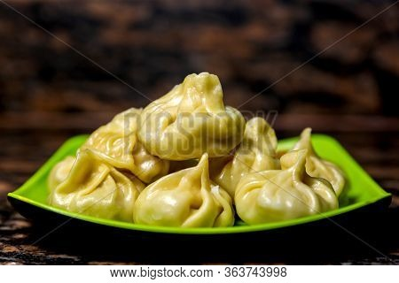 Home Made Traditional Dumpling Momos Food Of Nepal Served On A Plate ,dumpling Momo. Selective Focus