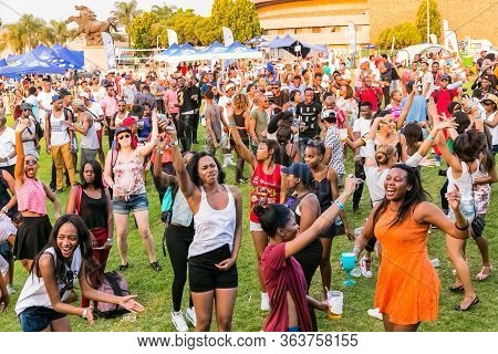 Crowd Of Diverse Young People Dancing And Having Fun At Day Time Open Air Concert