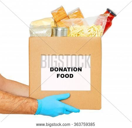 Coronavirus Donation Box. Delivery Food. Volunteer. Food Help. Delivery Mens Hands In Medical Gloves