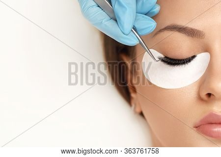 Eyelashes Extensions. Fake Eyelashes. Eyelash Extension Procedure.close Up Portrait Of Woman Eye Wit