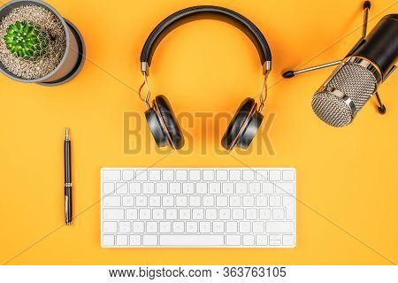 Podcasting And Podcast Recording Concept, Top View Of Microphone, Headphones And Computer Keyboard O