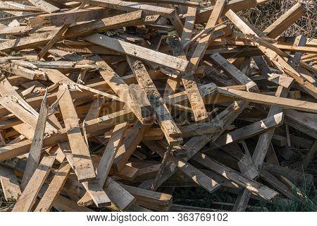 Large Disorganized Pile Of Old Waste Wood.
