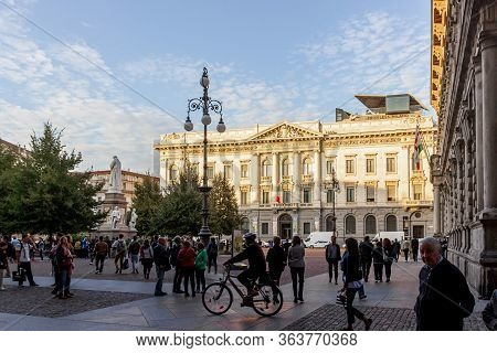 Milan, Italy, September 29, 2015 : Numerous Tourists Walk Along The Piazza Della Scala Near The Gall