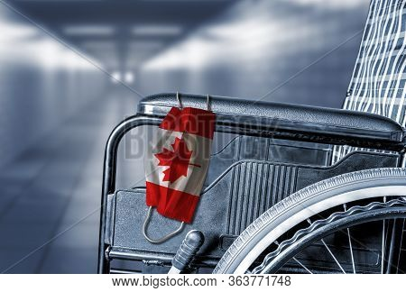3d Rendering Of Flag Of Canada On Face Mask Hanging On Empty Wheelchair In Hallway Of Canadian Hospi