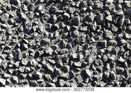 Texture Of A Gray Stone Wall. Decorative Wall Decoration With Cement And Rubble.