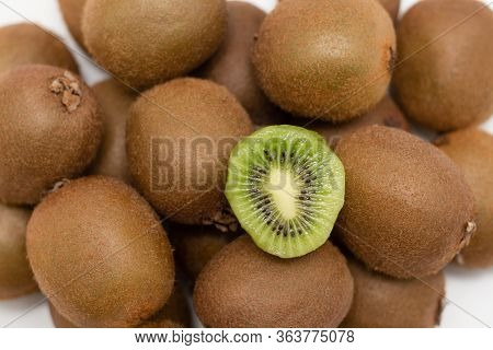 Closeup Of Whole And Cut Kiwi Fruits. Top Of Fresh Juicy Delicious Kiwifruits. Healthy Nutrition Or