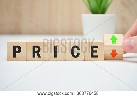 Concept Of Price Change Falling And Rising Abstractly On Wooden Blocks. Close Up.