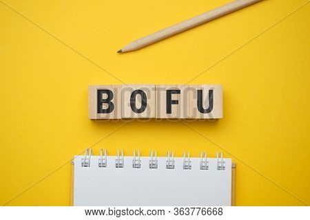 Modern Marketing Buzzword - Bofu Bottom Of Funnel. Top View On Wooden Table With Blocks. Top View. C