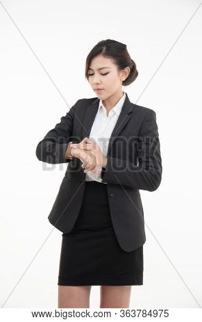 Asian Young Beautiful Business Woman Dress In Black Suit And Short Skirt With Smart Watch Isolated O