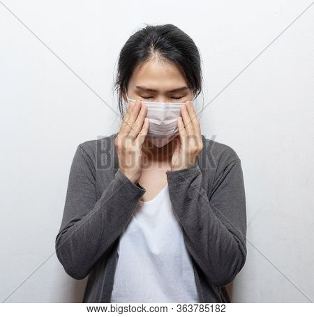 Asian Woman Wearing Facial Mask Hands Cover Face And Sneeze For Protection From Air Pollution Or Vir