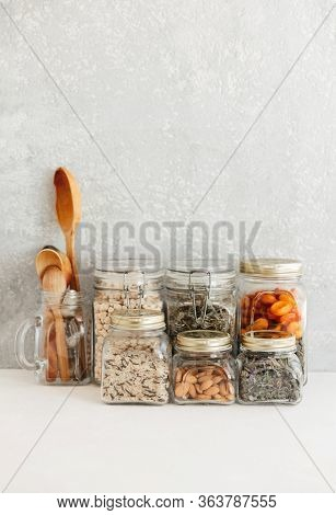 Food Set. Raw Cereals, Pasta, Groats, Organic Legumes And Useful Seeds In Glass Jars. Vegan Source O