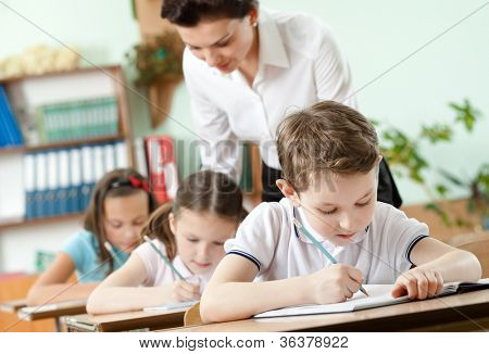 Teacher conducts the task performing by her pupils