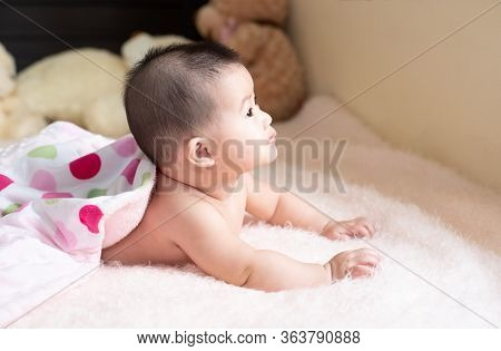 Close-up Of Unrecognizable Cute Baby Shaking Feet While Lying In Bed, Innocence Baby Development Con