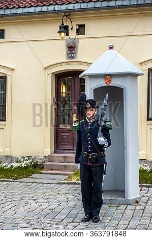 Oslo, Norway-july 27, 2013: Sentry On Duty. A Soldier Of The Norwegian Royal Guard Of Honor Stands W