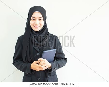 Half Length Portrait Of Asian Beautiful Muslim Young Woman Wearing Business Attire And Hijab Holding