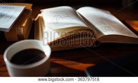 Old Hard Cover Archive Book With Notes And Coffee On Table.research And Education Concept.reading A