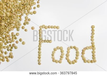 The Word Food Assembled With Grains Of Lentil On The White Background. Selective Focus. Healthy Eati