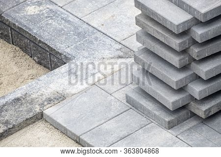Stack Of Grey Concrete Patio Stones On A Patio Construction Site