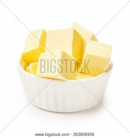 Butter Pieces In White Bowl Isolated On White Background. Butter Cubes.