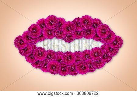 Fuchsia Dahlias In The Shape Of Lips. The Teeth Are Made Of White Aster. Art Object. Beauty Style. P