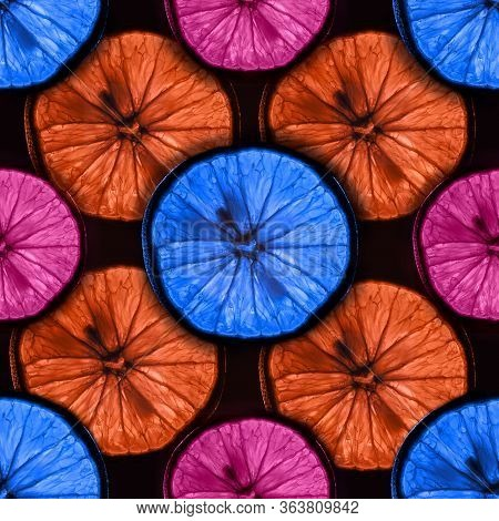 Seamless Pattern Of Slices Of Multicolor Citrus Fruit With Backlight Isolated On Black Background, C