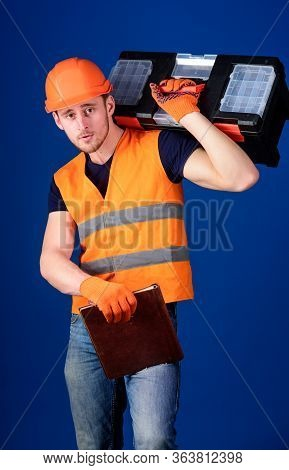 Worker, Repairer, Repairman, Builder On Calm Face Carries Toolbox On Shoulder, Ready To Work. Servic