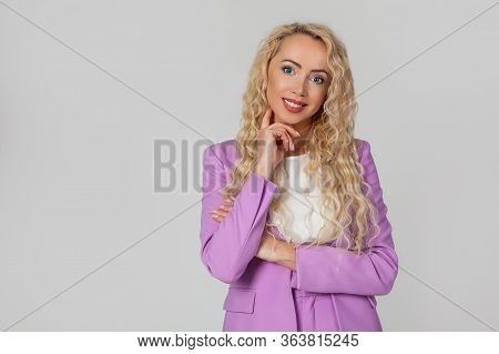 Smiling Attractive Happy And Successful European Blond Woman Smiling, Expressing Confidence, Looking